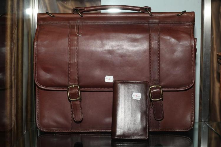 BURGUNDY LEATHER BRIEFCASE WITH GOLD-TONE BUCKLES AND SMALL LEATHER AGENDA,