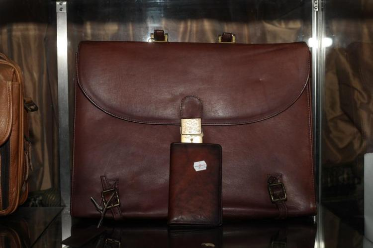 REDDISH-BROWN BRIEFCASE WITH GOLD-TONE BUCKLES AND SMALL AGENDA,