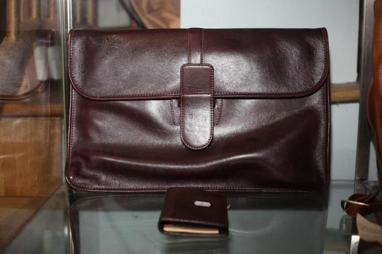 BURGUNDY LEATHER ENVELOPE BRIEFCASE AND SMALL DATE BOOK,