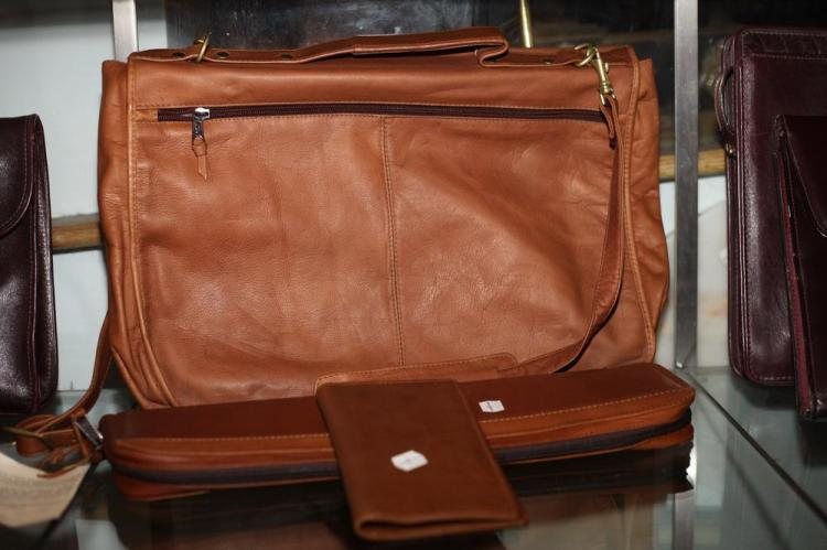 CINNAMON LEATHER BRIEFCASE, MATCHING TIE CASE AND SMALL WALLET.