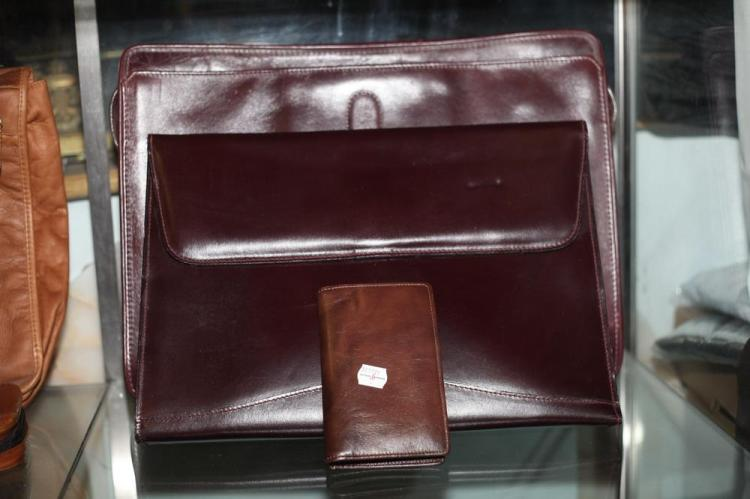 BURGUNDY LEATHER ITEMS: ONE BRIEFCASE, ONE ENVELOPE CASE; ONE SMALL DATE BOOK.