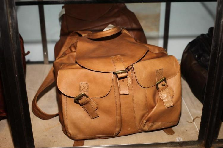 TWO BROWN LEATHER BACKPACKS, ONE CARAMEL; ONE BROWN,