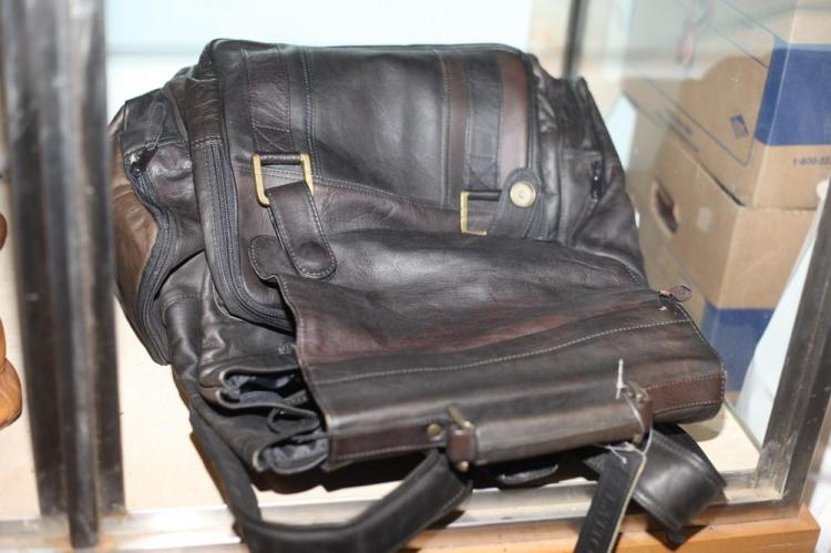 BLACK LEATHER BACKPACK WITH GOLD-TONE BUCKLES,