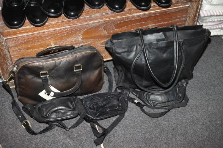 BLACK LEATHER BAGS: THREE POUCHES, ONE LARGE HANDBAG AND ONE MEDIUM HANDBAG.