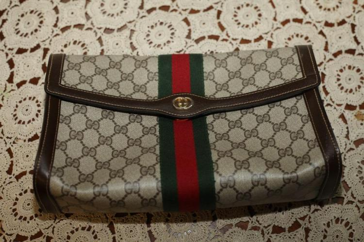 GUCCI POUCH WITH GUCCI LOGO AND RED AND GREEN CENTER STRIPE,