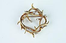 18K YELLOW GOLD AND DIAMOND BRANCH DESIGN PIN.