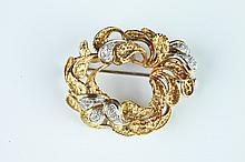 CUSTOM-MADE 18K YELLOW AND WHITE GOLD AND DIAMOND STYLIZED OVAL WREATH DESIGN PIN.