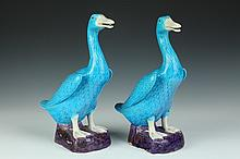 PAIR CHINESE TURQUOISE AND AUBERGINE PORCELAIN FIGURES OF DUCKS. - 14 in. high.