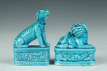 CHINESE TURQUOISE PORCELAIN FIGURE OF FU DOG, Qing Dynasty. - Larger: 3 1/8 in. high.
