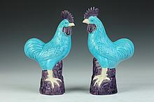 PAIR CHINESE AUBERGINE AND TURQUOISE PORCELAIN FIGURES OF COCKERELS. - 10 in. high.