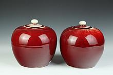 PAIR CHINESE COPPER RED PORCELAIN JARS AND COVERS. - 8 1/2 in. high.