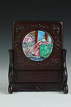 CHINESE FAMILLE ROSE PORCELAIN CIRCULAR PLAQUE INSET ROSEWOOD TABLE SCREEN. - 9 in. high.