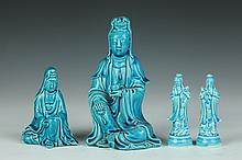 FOUR CHINESE TURQUOISE PORCELAIN FIGURES OF GUANYIN, Late 19th/early 20th Century. - Largest: 7 in. high.