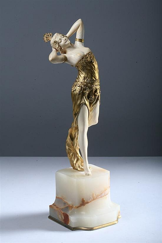 HENRI FUGÈRE (French, 1872-1944). Exotic Dancer, Ivory and gilt-bronze; on an onyx base. Signed H Fugère and numbered 3813.