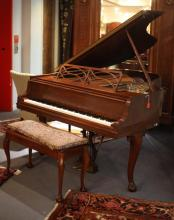 STEINWAY MODEL M MAHOGANY BABY GRAND PIANO WITH BENCH IN THE CHIPPENDALE STYLE. Serial #505380/S1281. - Piano: 68