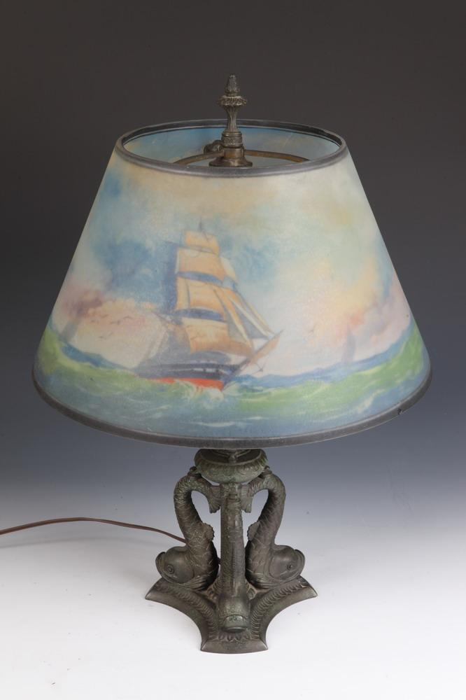 20TH CENTURY PAIRPOINT DOLPHIN FORM TWO LIGHT METAL LAMP WITH PAINTED SHADE DEPICTING SAILING SHIPS, 20th Century. Marked Pairpoint to