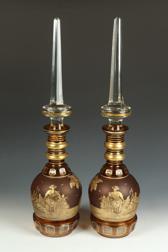 PAIR OF 19TH CENTURY CONTINENTAL CUT AMBER-TO-COLORLESS GILT-PAINTED LARGE DECANTERS WITH STOPPERS. 19th Century. Signed A. Otto.