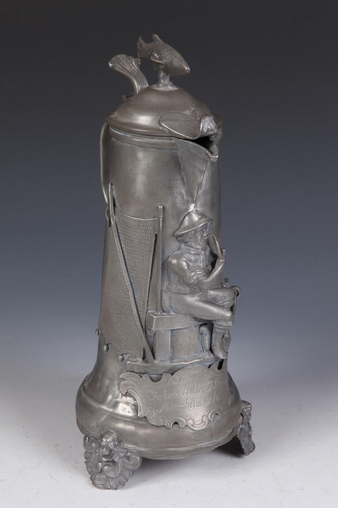 19TH CENTURY GERMAN PEWTER TANKARD WITH RELIEF SEAMAN AND FISH FINIAL, 19th century. - 13 1/4