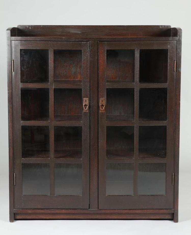 20TH CENTURY GUS STICKLEY #717 TWO DOOR BOOKCASE, Early 20th Century. Marked to back. - 56 3/8
