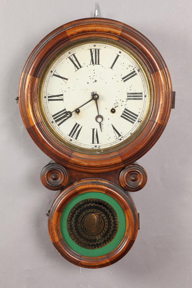 LATE 19TH CENTURY E. INGRAHAM & CO. ICONIC OAK WALL CLOCK. Late 19th Century, Bristol, CT. Paper label to interior. - 21 1/8