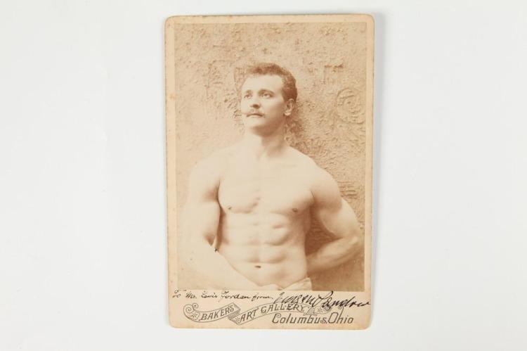 SIGNED CABINET CARD OF EUGEN SANDOW. circa 1895. - 6.5 in. x 4 in.