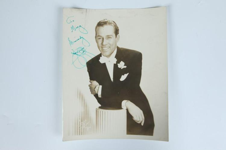 13 MOSTLY AUTOGRAPH SIGNED BLACK AND WHITE AND COLOR PHOTOGRAPHS OF POPULAR SINGERS, COMPOSERS, AND BAND LEADERS.