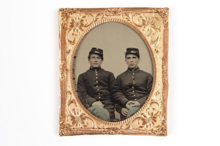 TINTED TINTYPE OF TWO MEN IN MILITARY UNIFORMS HOLDING HANDS, GAY INTEREST, Civil War era. - 3 in. x 2.5 in.