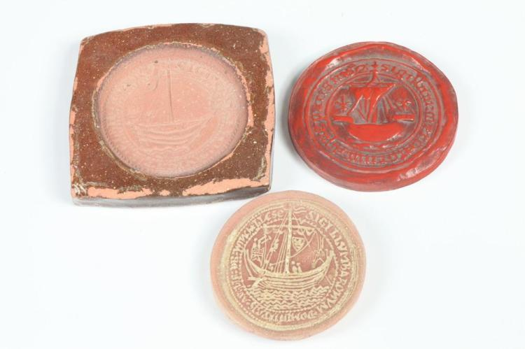 FRENCH SCHOOL. TERRA COTTA MEDALLIONS AND MOLD, Two terra cotta medallions and one terra cotta mold. One medallion with red patina 89 m