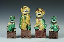 FOUR CHINESE SANCAI PORCELAIN FIGURES OF FU LIONS, Marked