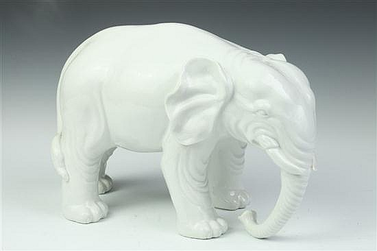 CHINESE BLANC-DE-CHINE PORCELAIN FIGURE OF ELEPHANT, - 15 in. long x 9 1/2 in. high.