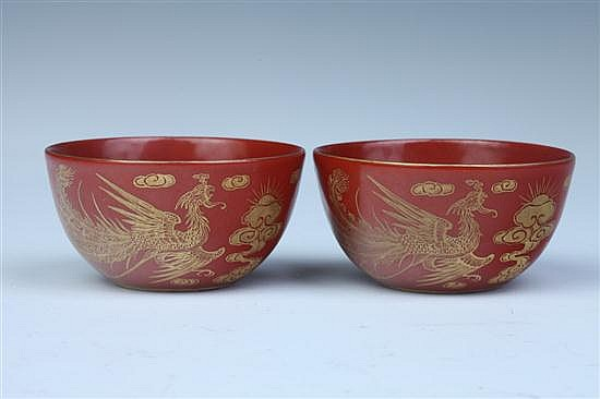 PAIR CHINESE GILT AND IRON RED WINE CUPS, Qianlong underglazed blue seal mark. - 2 1/2 in. diam.
