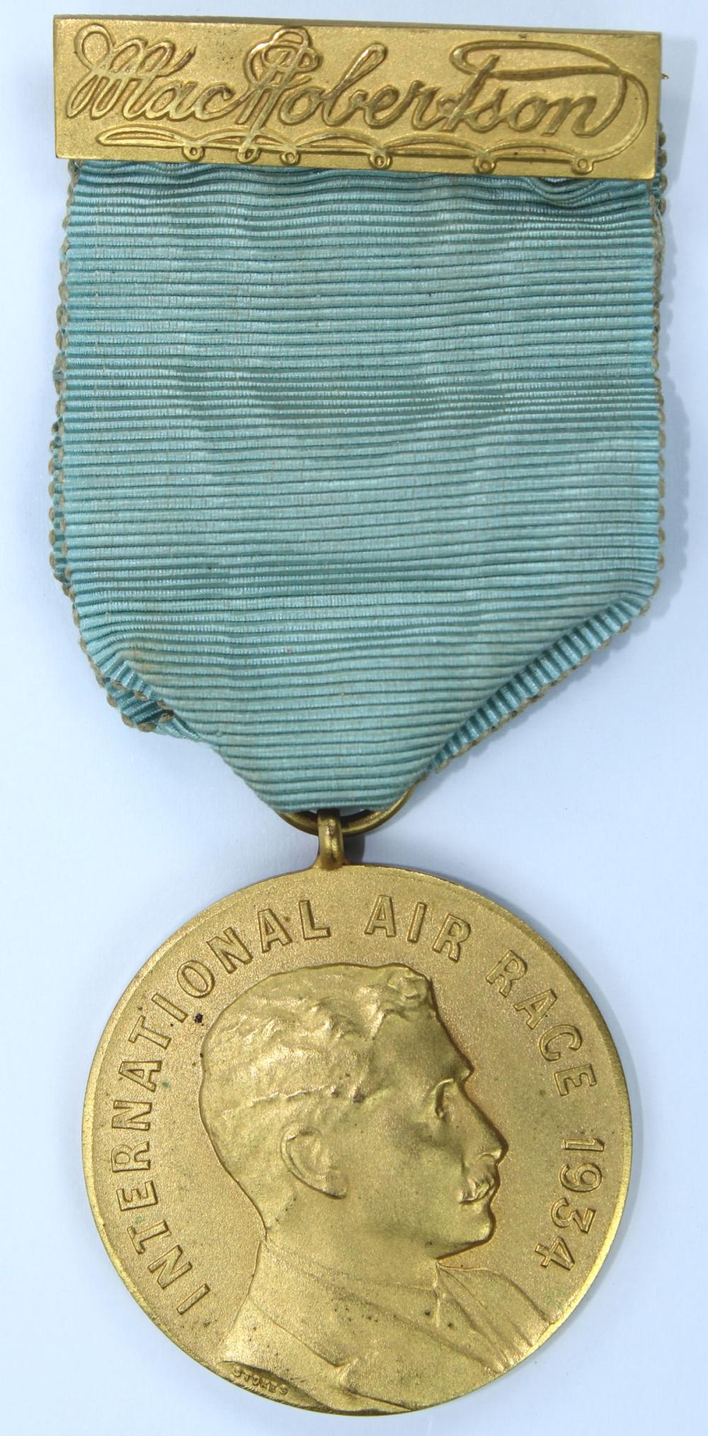Competitors Medal for the 1934 'MacRobertson's London to Melbourne International Air Race,' Uncirculated with original suspension bar & ribbon