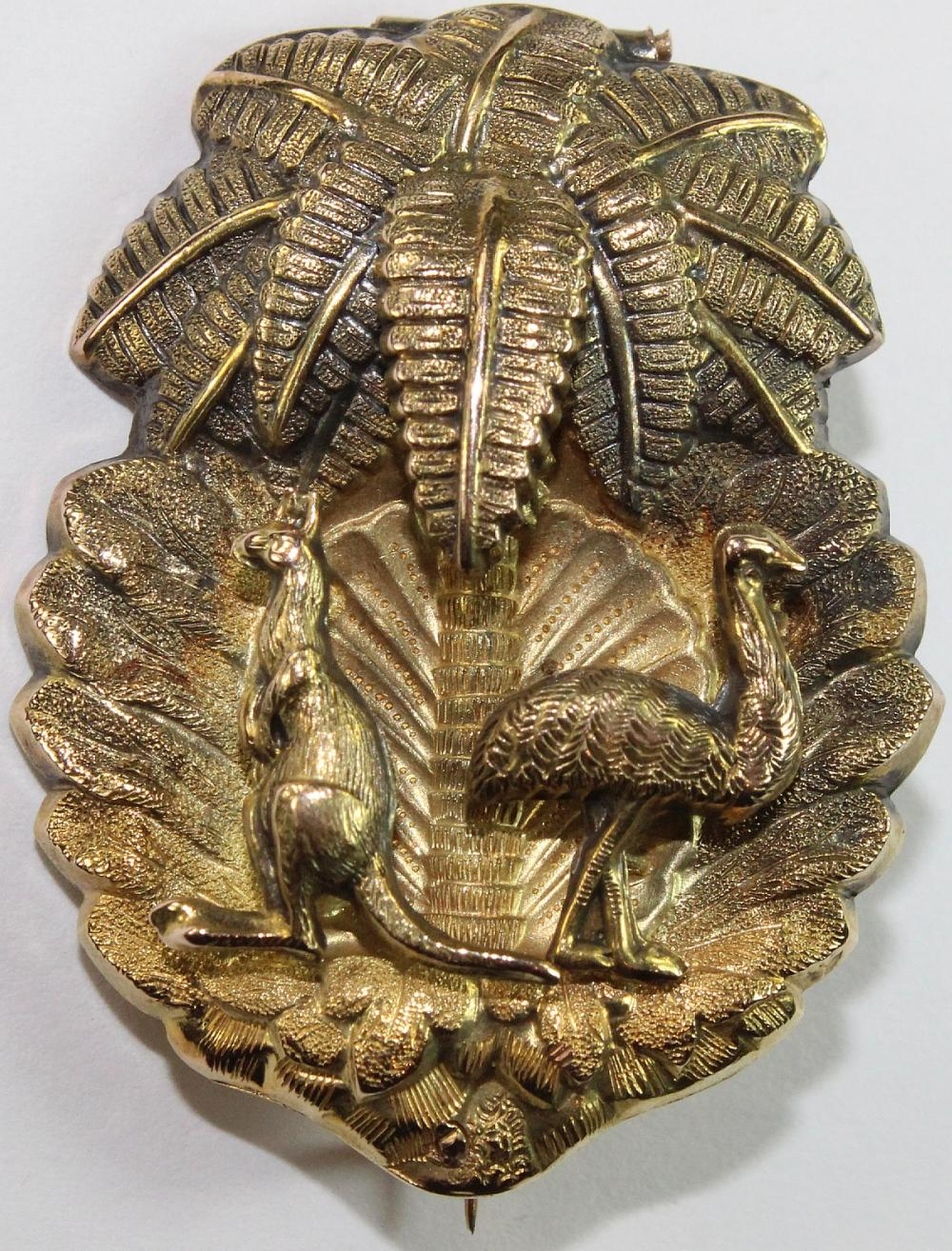 Australian 19th Century Gold Brooch in 18ct Gold featuring a 'Kangaroo & Emu' beneath a Palm Frond