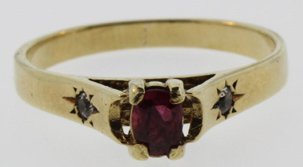 Small Ruby flanked by two small Diamonds in a 9ct Gold Ring