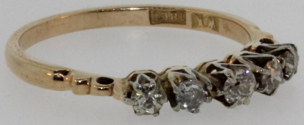 Diamond Bridge Ring in 18ct Yellow Goldwith five small Diamonds