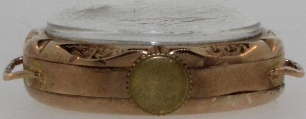 Vintage Woman's Watch in 9ct Gold with ornate Mother of Pearl Dial