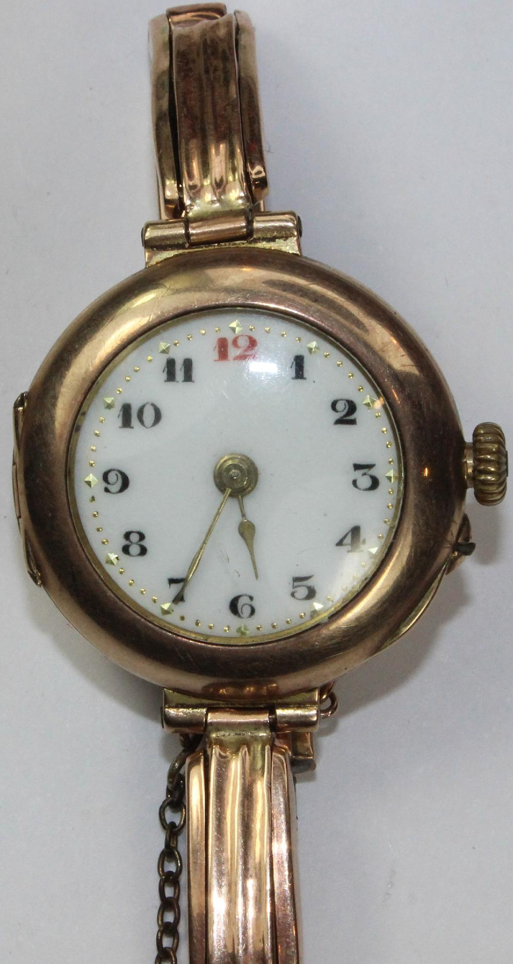 Vintage Woman's Watch in 9ct Gold with Arabic numerals on a simple White Porcelain Dial