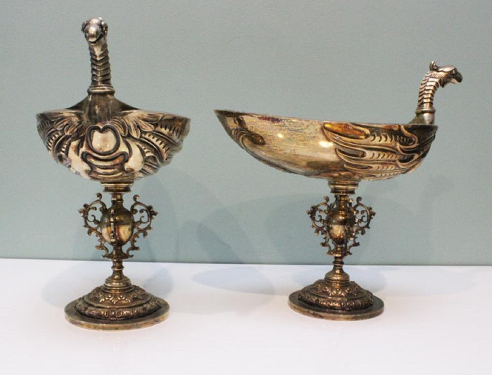 Impressive suite comprising a Sterling Silver Urn with gilded interior and four matching Silver Goblets in the form of Griffins. Housed in a custom wooden display case.