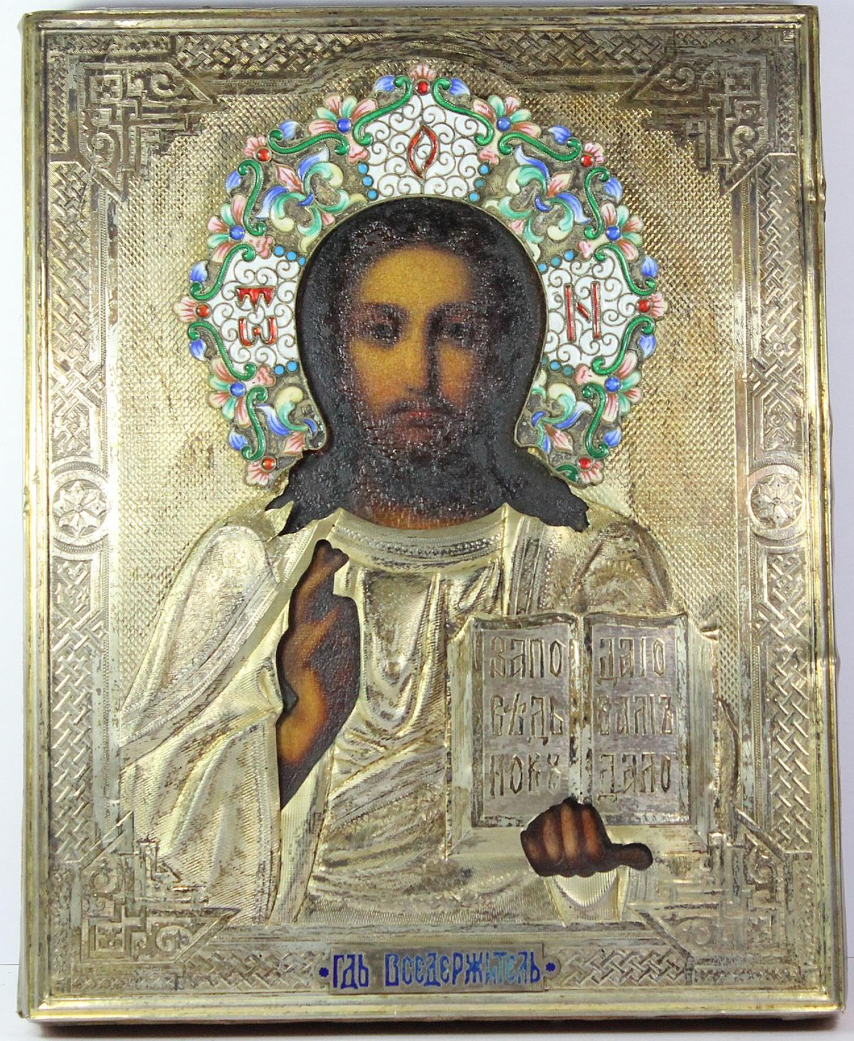 Naively painted depiction of Jesus Christ with an impressed and pierced gilt silver overlay.