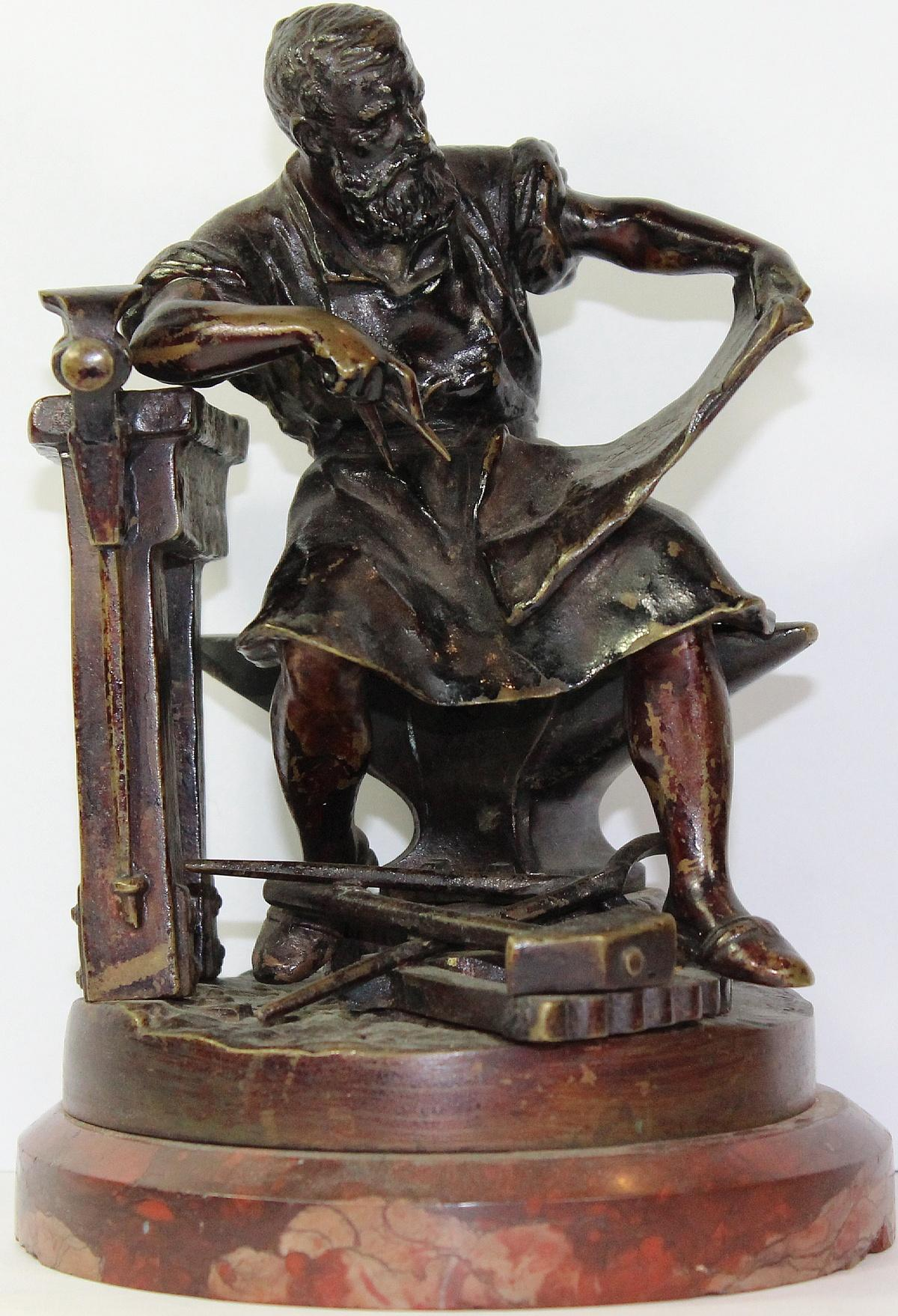 19th Century Bronze of seated Blacksmith on a Red Marble base