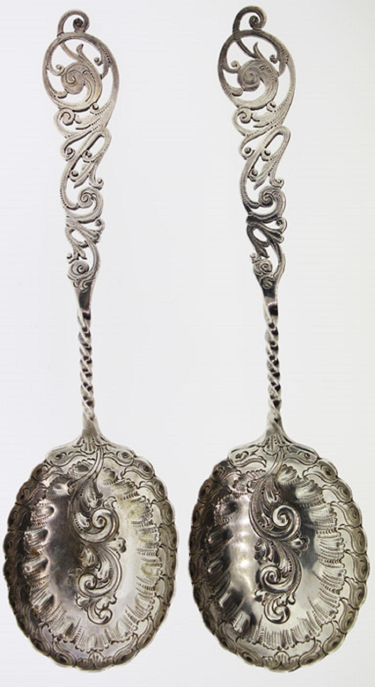 Pair of ornate Antique Silver (0.925) Serving Spoons