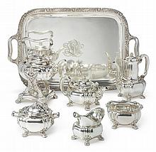AN AMERICAN SILVER CHRYSANTHEMUM PATTERN SIX-PIECE TEA AND COFFEE SET WITH MATCHING TRAY, TIFFANY & CO., NEW YORK, CIRCA 1882 |