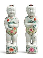 A PAIR OF CHINESE EXPORT FAMILLE-ROSE FIGURES OF BOYS<BR>18TH CENTURY |