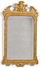 A GEORGE I CARVED GILTWOOD AND GILT-GESSO MIRROR, CIRCA 1720 |