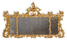 A GEORGE II CARVED GILTWOOD OVERMANTEL MIRROR, MID-18TH CENTURY |