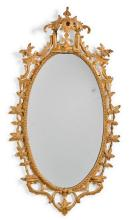 A GEORGE III CARVED OVAL GILTWOOD MIRROR, CIRCA 1760, POSSIBLY IRISH |