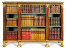 A REGENCY STYLE SIMULATED ROSEWOOD AND PARCEL GILT BREAKFRONT OPEN BOOKCASE, 20TH CENTURY |