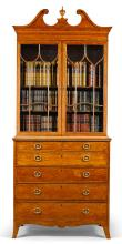 A GEORGE III ROSEWOOD BANDED SATINWOOD SECRETAIRE BOOKCASE, CIRCA 1785, ATTRIBUTED TO GILLOWS |