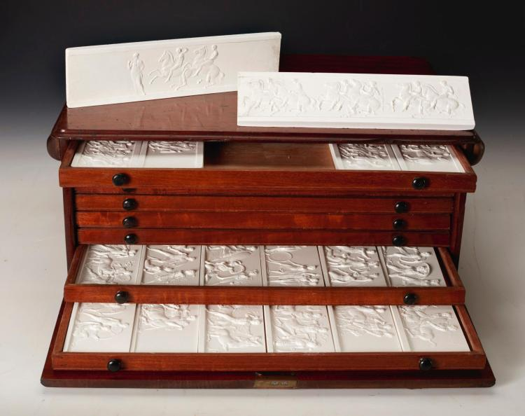 HENNING, SET OF 48 PLASTER CAST RELIEFS OF THE PARTHENON MARBLES IN A FITTED WOODEN CABINET