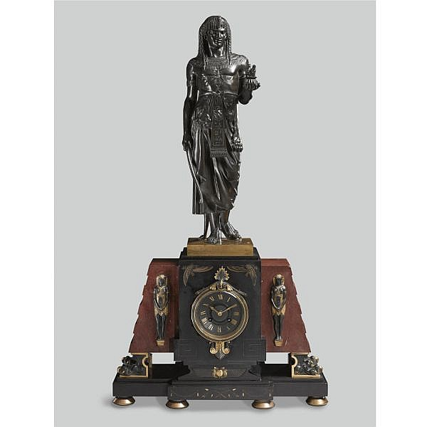 Georges Emile Henri Servant , French 1828 - c.1890 Egyptomania Mantel Clock bronze, dark green patina, the figure mounted on a gilt-bronze mounted marble mantel clock.